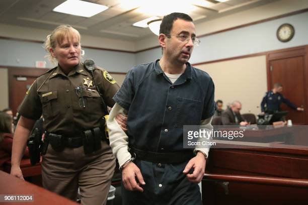 Larry Nassar appears in court to listen to victim impact statements during his sentencing hearing after being accused of molesting more than 100...