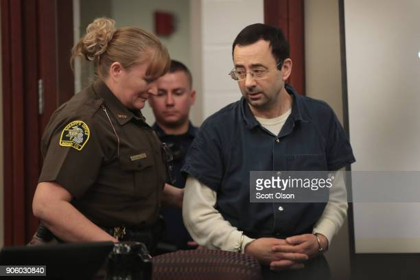 Larry Nassar arrives in court to listen to victim impact statements during his sentencing hearing after being accused of molesting more than 100...