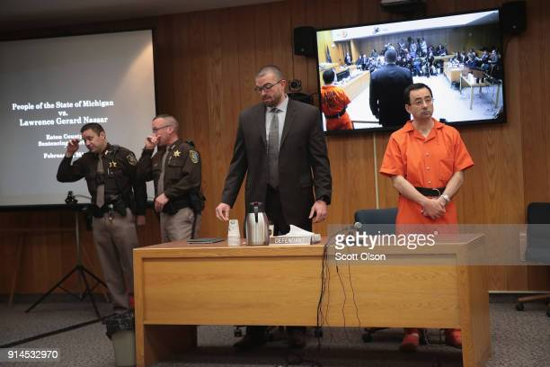 Larry Nassar arrives in court with his attorney Matt Newburg as he is sentenced by Judge Janice Cunningham for three counts of criminal sexual...