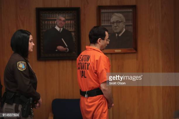 Larry Nassar is led from the courtroom after being sentenced by Judge Janice Cunningham to 40 to 125 years in prison for three counts of criminal...