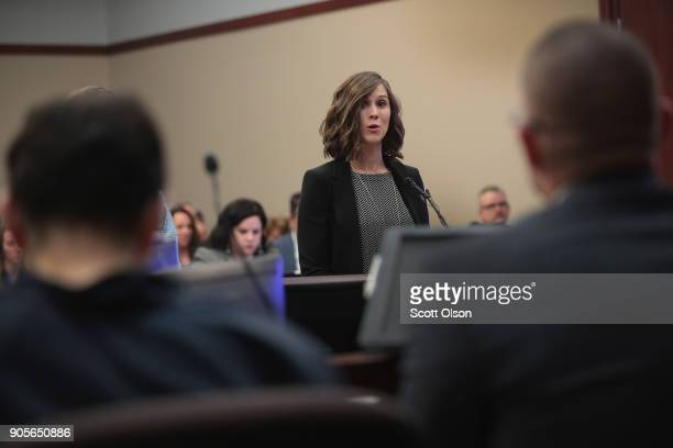 Larry Nassar listens to a victim impact statement from Bethany Bauman during a sentencing hearing after being accused of molesting about 100 girls...