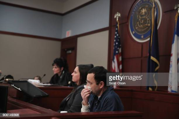 Larry Nassar listens to Carrie Hogan deliver a victim impact statement at his sentencing hearing on January 17 2018 in Lansing Michigan Nassar has...