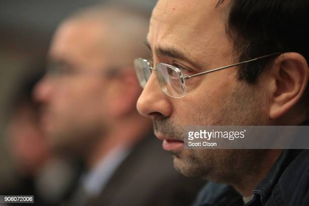 Larry Nassar listens to victim impact statements during his sentencing hearing after being accused of molesting more than 100 girls while he was a...