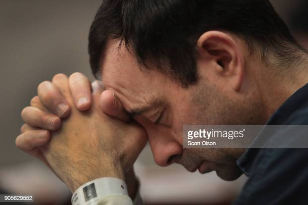 Larry Nassar listens to victim impact statements prior to being sentenced after being accused of molesting about 100 girls while he was a physician...