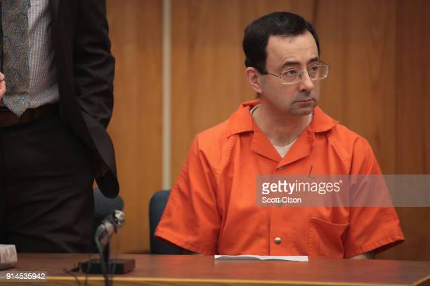 Larry Nassar sits in court listening to statements before being sentenced by Judge Janice Cunningham for three counts of criminal sexual assault in...