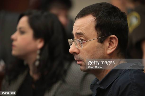 Larry Nassar sits with his attorney Shannon Smith as he appears in court to listen to victim impact statements prior to being sentenced after being...