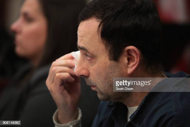 Larry Nassar wipes a tear as he listens to Carrie Hogan deliver a victim impact statement at his sentencing hearing on January 17 2018 in Lansing...