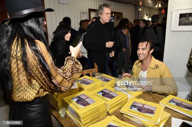 Larry Niehues signs copies of Nothing Has Changed during his book launch photography exhibition at Etiquette on November 21 2019 in Brooklyn New York