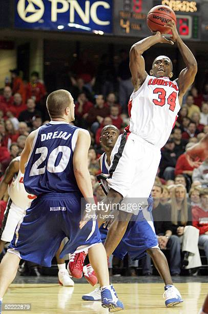 Larry O'Bannon of the Louisville Cardinals shoots the ball over Anthony Drejaj of the Saint Louis Billikens during the Conference USA game at Freedom...