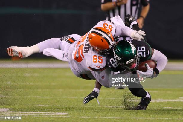 Larry Ogunjobi of the Cleveland Browns tackles Le'Veon Bell of the New York Jets in the second half at MetLife Stadium on September 16 2019 in East...