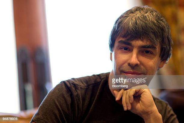 Larry Page cofounder of Google Inc smiles for a photograph while speaking with members of the media during the 26th annual Allen Co Media and...