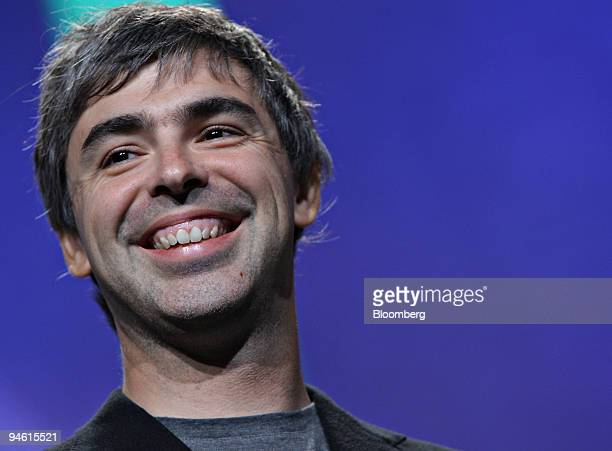 Larry Page cofounder of Google Inc stands onstage with others pledging to conduct a dozen global competitions for large scale inducement prizes...
