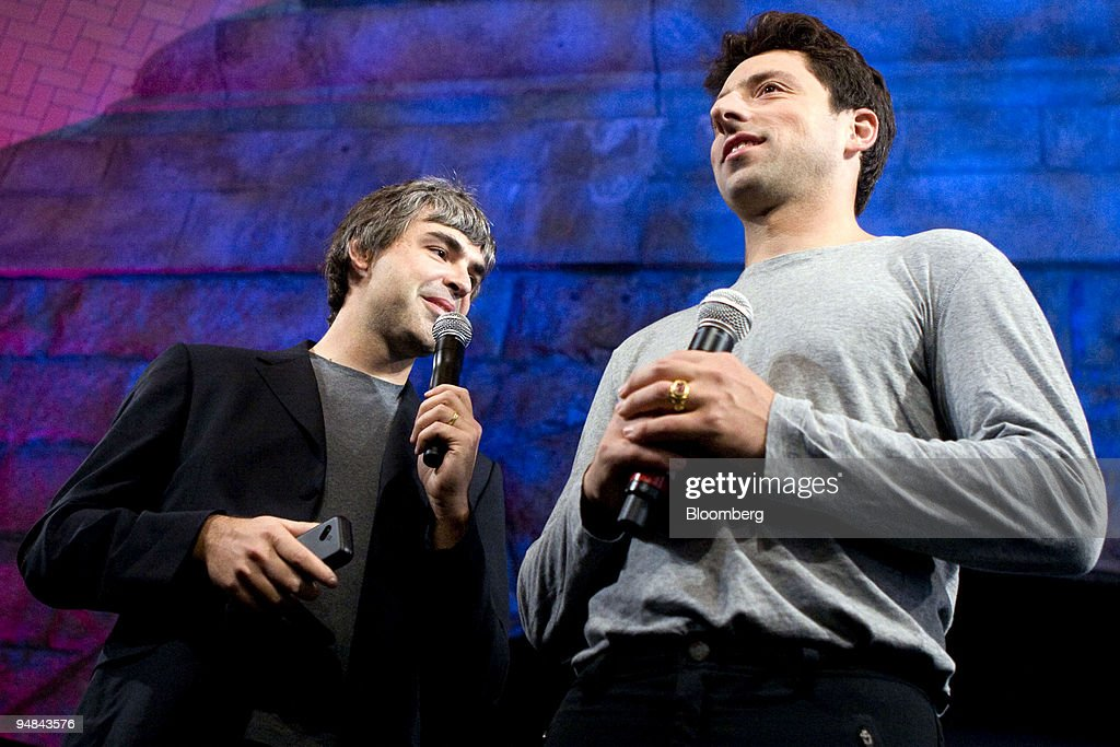 Larry Page, left, and Sergey Brin, co-founders of Google Inc., speak during the unveiling of the HTC Corp. G1 mobile phone by T-Mobile USA Inc. in New York, U.S., on Tuesday, Sept. 23, 2008. The phone is the first to run on Google Inc.'s Android software and will cost $179 with a two-year contract when it goes on sale in the U.S. on Oct. 22.