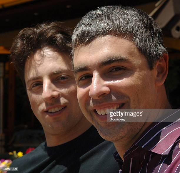 Larry Page president of products and cofounder of Google Inc right poses with Sergey Brin president of techonology and cofounder during the annual...