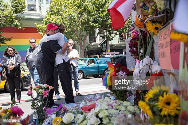 Larry Pascua hugs a friend at a makeshift vigil for those killed in the terrorist attack on a gay night club in Orlando FL on June 13 2016 in San...