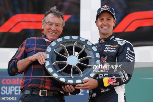 Larry Perkins poses for a photo with the winner of the Larry Perkins Trophy Jamie Whincup driver of the Red Bull Holden Racing Team Holden Commodore...
