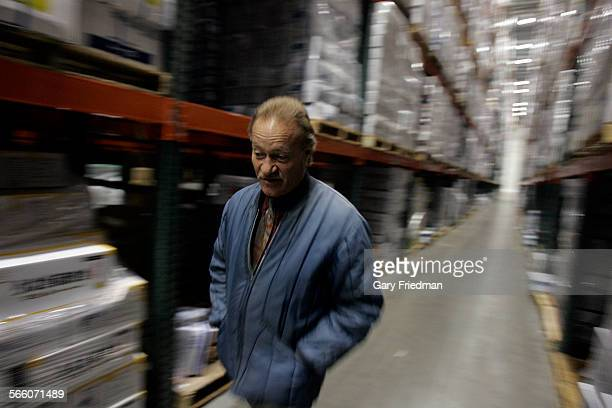 Larry Piles Walks In A Storage Area Of The Showa Marine Cold Downtown Los