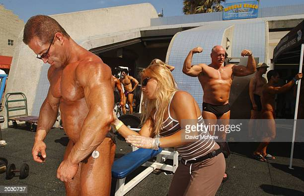 Larry Pollock gets oiled up for competition at the annual Venice Classic bodybuilding competition at Venice Beach on May 26 2003 in the Los Angeles...