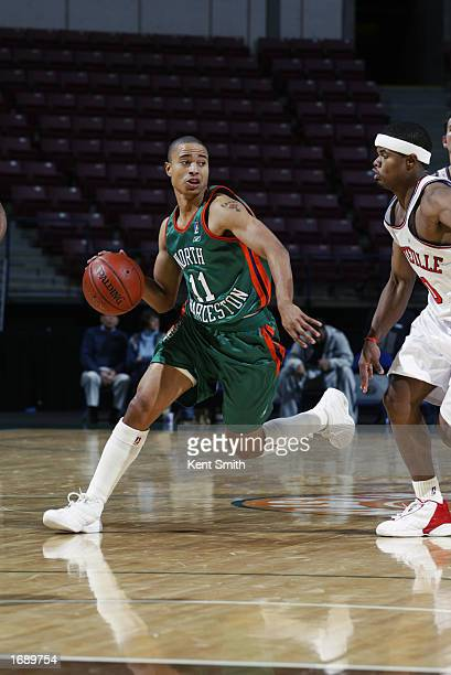 Larry Reid of the North Charleston Lowgators moves the ball at the perimeter during the NBDL game against the Fayetteville Patriots at North...