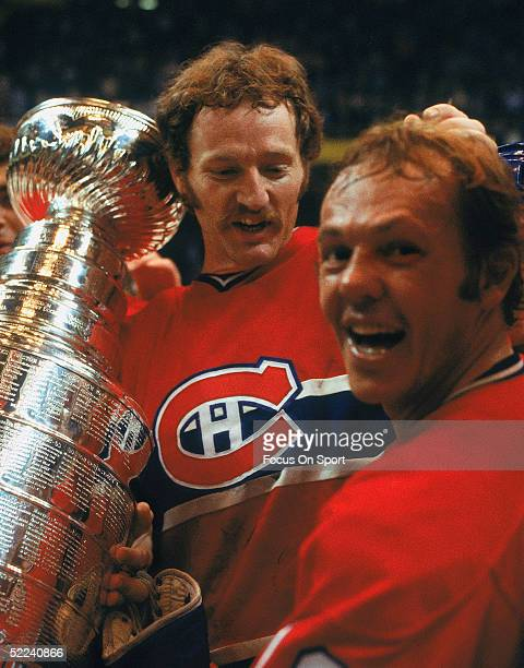 Larry Robinson and Yvan Cournoyer of the Montreal Canadiens celebrate with the Stanley Cup Trophy after defeating the Boston Bruins for the 1978...
