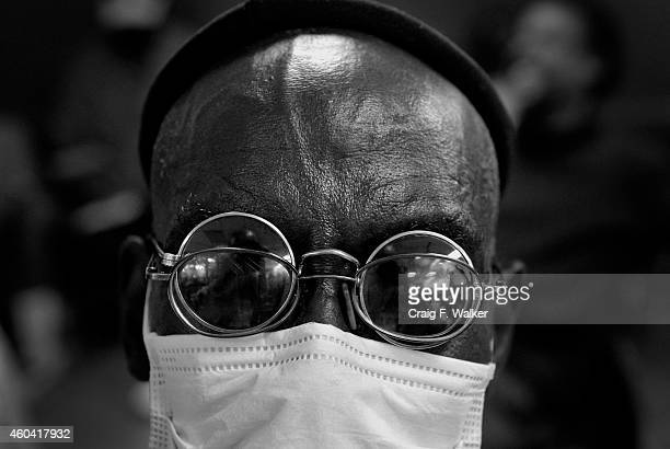 Larry Robinson Jr wear's his disguise while sitting at the Saint Francis Center in Denver CO August 12 2014 He is not wearing the mask because he is...