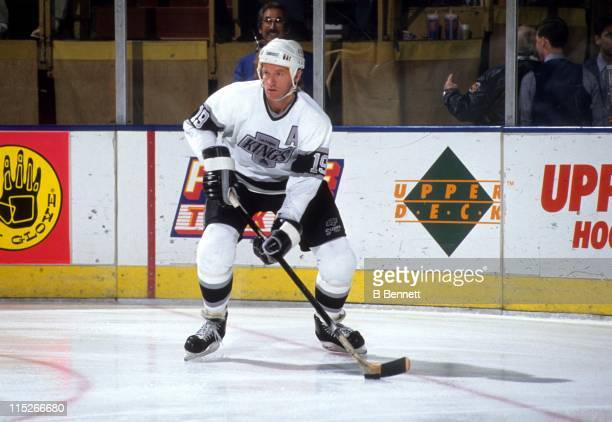 Larry Robinson of the Los Angeles Kings skates with the puck during an NHL game circa 1989 at the Great Western Forum in Inglewood California
