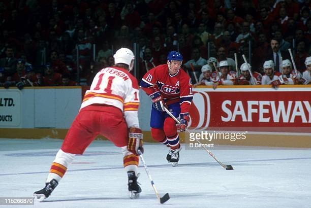 Larry Robinson of the Montreal Canadiens looks to pass as Colin Patterson of the Calgary Flames defends during the 1989 Stanley Cup Finals in May...