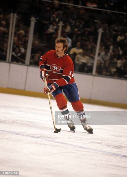 Larry Robinson of the Montreal Canadiens skates with the puck during an NHL game circa 1973