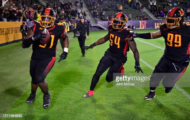 Larry Rose is followed by Taiwan Jones and Latarius Brady of the LA Wildcats after he scored touchdown against the Tampa Bay Vipers at Dignity Health...