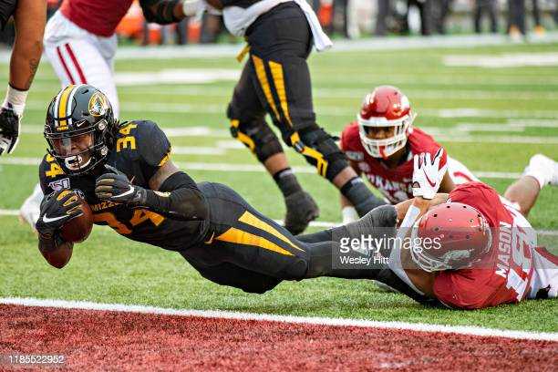 Larry Rountree III of the Missouri Tigers dive into the end zone for a touchdown during the first half of a game against the Arkansas Razorbacks at...