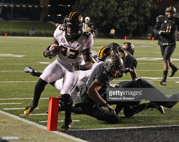 Larry Rountree III of the Missouri Tigers scores a touchdown against LaDarius Wiley of the Vanderbilt Commodores during the first half at Vanderbilt...