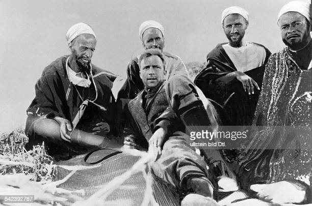 Larry Rue reporter of the 'Chicago Tribune' with Berbers in the camp of Abd elKrim the leader of the Moroccan Berbers of the Rif Mountains