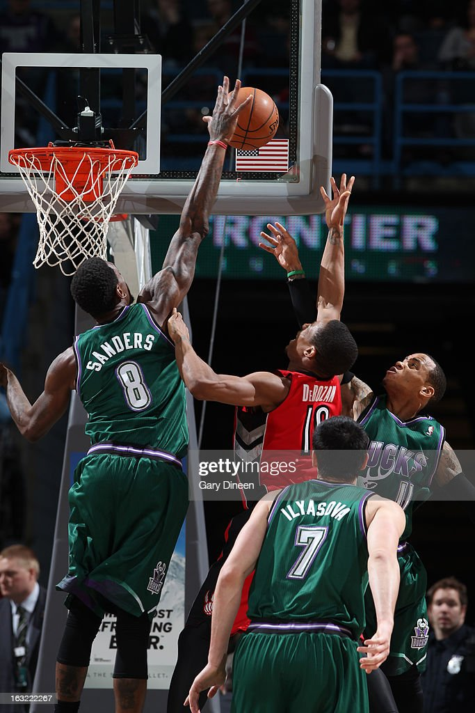 Larry Sanders #8 of the Milwaukee Bucks blocks the shot of DeMar DeRozan #10 of the Toronto Raptors on March 2, 2013 at the BMO Harris Bradley Center in Milwaukee, Wisconsin.