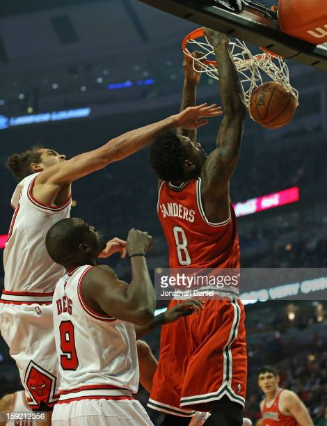 Larry Sanders of the Milwaukee Bucks dunks the ball under pressure from Loul Deng and Joakim Noah of the Chicago Bulls at the United Center on...