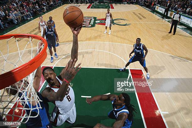 Larry Sanders of the Milwaukee Bucks shoots against Dirk Nowitzki of the Dallas Mavericks on March 12 2013 at the BMO Harris Bradley Center in...