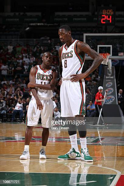 Larry Sanders of the Milwaukee Bucks talks with teammate Earl Boykins during a game against the Minnesota Timberwolves on October 22 2010 at the...