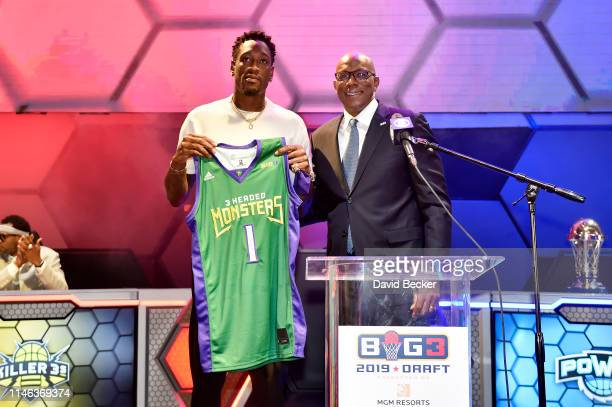Larry Sanders poses with BIG3 Commissioner Clyde Drexler after being drafted at by the 3 Headed Monsters in the first round during the BIG3 Draft at...