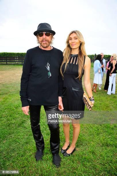 Larry Sands and Christina Sands attend HEAT honoring Donna Karan Steven Klein and Hope Klein Langer at Steven Klein's home West Kill Farm on August...