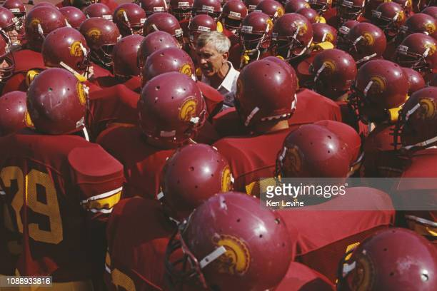 Larry Smith Head Coach for the University of Southern California USC Trojans gathers his team around him for a pre game talk before the NCAA Pac10...