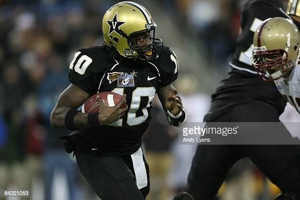 Larry Smith of the Vanderbilt Commodores carries the ball against the Boston College Eagles during the Gaylord Hotels Music City Bowl at LP Field on...