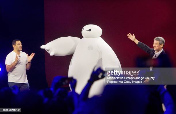 Larry Sparks at left and Shinji Hashimoto introduce Baymax from the Big Hero 6 movie at the D23 Expo on Sunday in Anaheim They announced that the new...