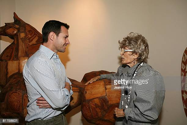 Larry Sullivan talks with Maxine Kim StussyFrankel at theTrigg Ison Fine art exhibit for the work of Maxine Kim StussyFrankel at her home June 28...