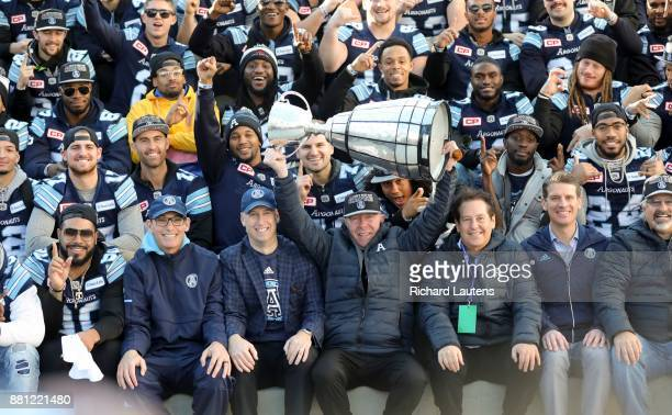 TORONTO ON NOVEMBER 28 Larry Tanenbaum representing the owners of the Argos hoists the cup The Toronto Argonauts football club celebrated their Grey...