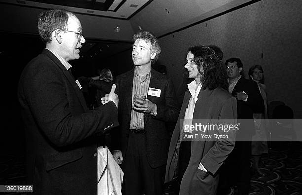 Larry Tesler from Apple Computer and Colleen Barton from GeoMechanics International talk with an unidentified man at the annual PC Forum Phoenix...