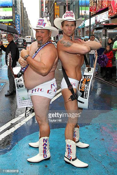 Larry the Cable Guy and the Naked Cowboy film The History Channel's Only in America with Larry the Cable Guy in Times Square on May 4 2011 in New...