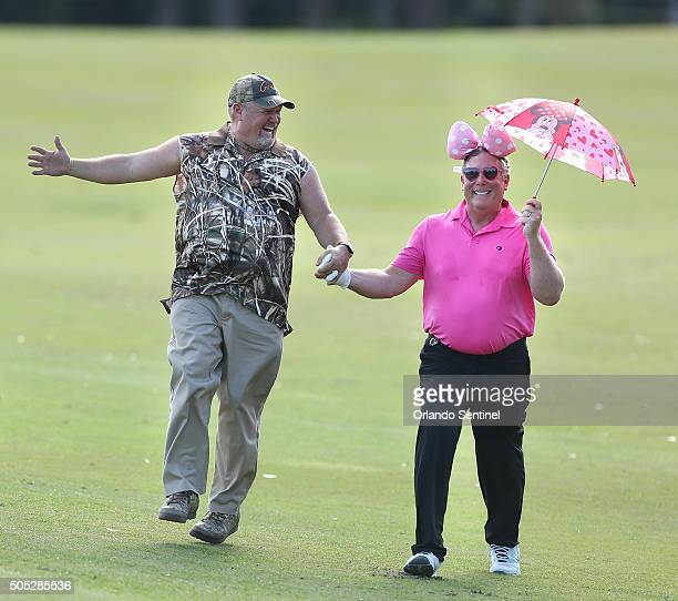 Larry The Cable Guy left skips down the 18th fairway with Stephen Cloobeck right during the Diamond Resorts Invitational at The Golden Bear Club at...