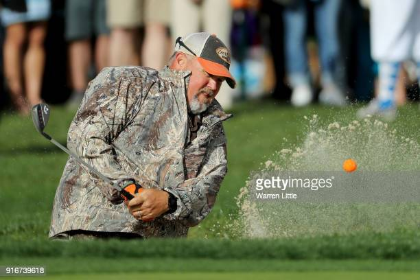 Larry the Cable Guy plays his shot from the bunker on the 18th hole during Round Three of the ATT Pebble Beach ProAm at Spyglass Hill Golf Course on...