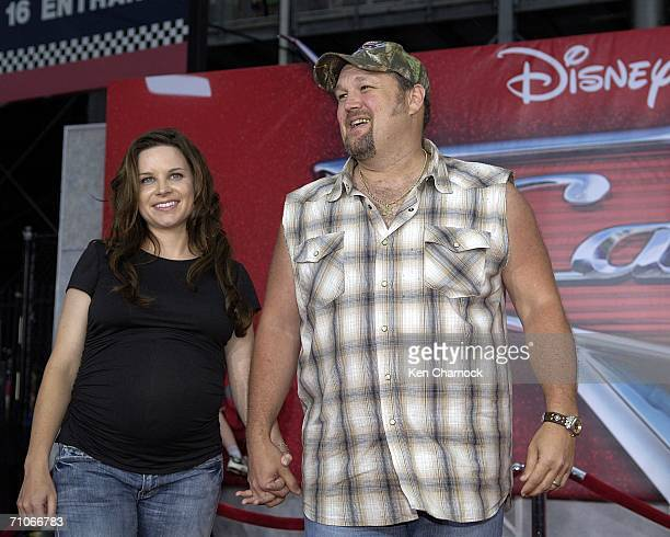 Larry the Cable Guy voice of Mater and his wife Cara Whitney attend the world premiere screening of the Disney and PIXAR movie Cars at Lowe's Motor...