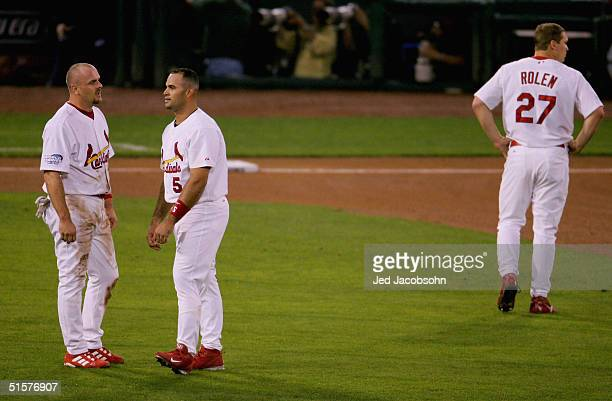 Larry Walker Albert Pujols and Scott Rolen of the St Louis Cardinals react after a doubleplay that ended the first inning against the Boston Red Sox...