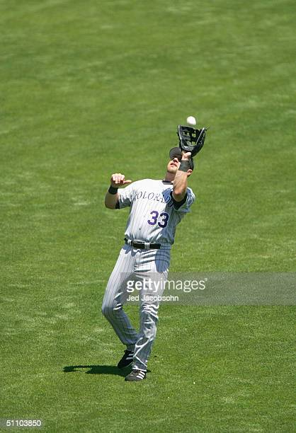 Larry Walker of the Colorado Rockies gets under a pop fly ball to make a catch during the game against the San Francisco Giants at SBC Park on July...